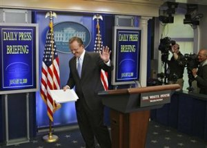 White House Press Secretary Robert Gibbs leaves the podium after delivering the daily White House Briefing to the media.